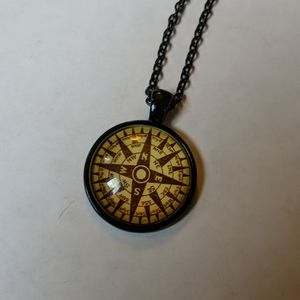 🧭 brown and gold compass necklace on black chain
